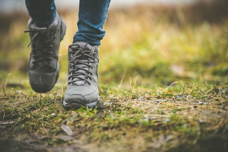 Walking in a field with boots on