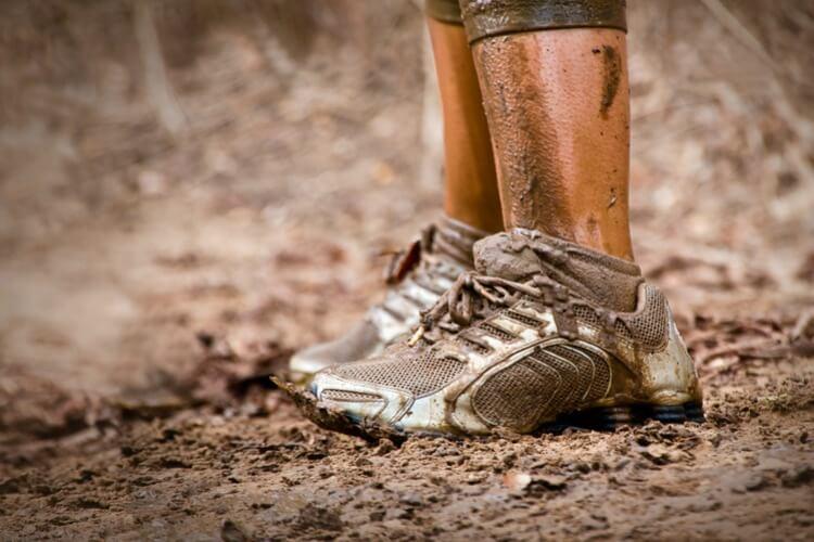 Endurance runners feet in mud