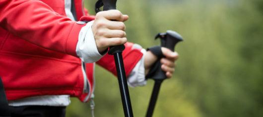 Woman nordic walking using walking poles